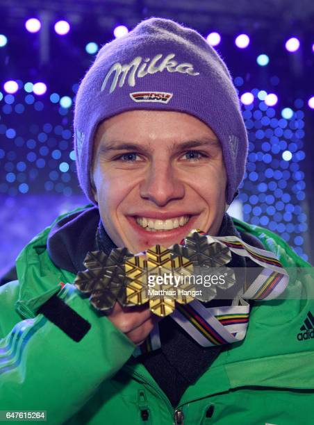 Silver medalist Andreas Wellinger of Germany celebrates with his three medals during the medal ceremony for the Men's Ski Jumping HS130 at the FIS...