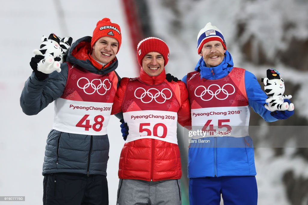 Silver medalist, Andreas Wellinger of Germany, gold medalist, Kamil Stoch of Poland and bronze medalist, Robert Johansson of Norway celebrate on the podium following the Ski Jumping - Men's Large Hill on day eight of the PyeongChang 2018 Winter Olympic Games at Alpensia Ski Jumping Center on February 17, 2018 in Pyeongchang-gun, South Korea.