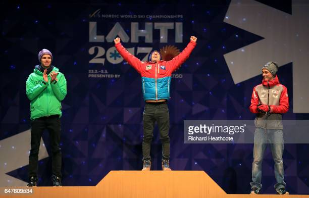 Silver medalist Andreas Wellinger of Germany gold medalist Stefan Kraft of Austria and bronze medalist Piotr Zyla of Poland celebrate during the...