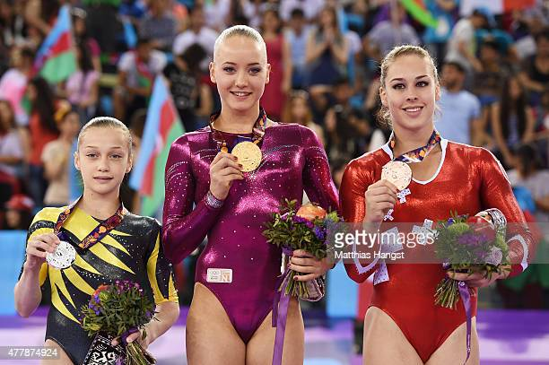 Silver medalist Andreea Iridon of Romania gold medalist Lieke Wevers of the Netherlands and bronze medalist Giulia Steiingruber of Switzerland stand...