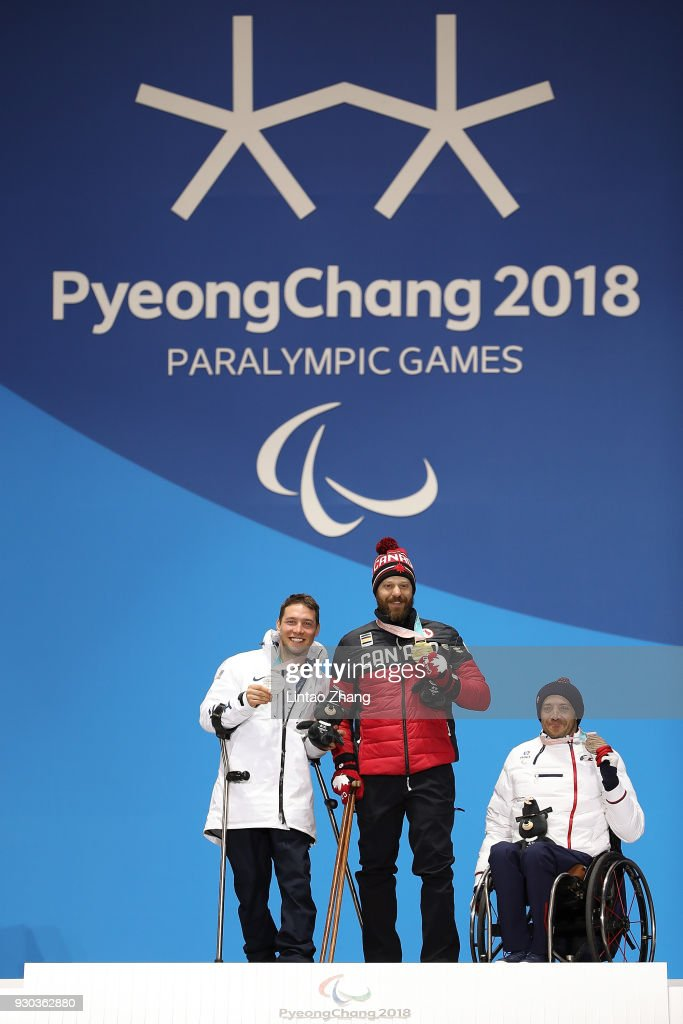 Silver Medalist Andrew Kurka of the United States, Gold Medalist Kurt Oatway of Canada and Bronze Medalist Frederic Francois of France pose during the victory ceremony of the Men's Sitting Super-G during day two of the PyeongChang 2018 Paralympic Games on March 11, 2018 in Pyeongchang-gun, South Korea.