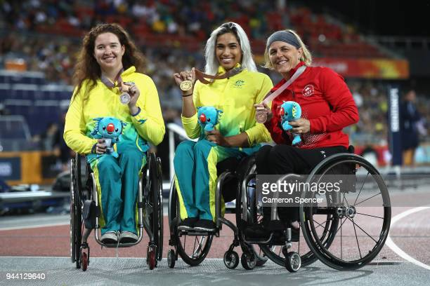 Silver medalist Angela Ballard of Australia gold medalist Madison de Rozario of Australia and bronze medalist Diane Roy of Canada pose during the...