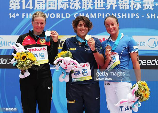 Silver medalist Angela Maurer of Germany gold medalist Ana Marcela Cunha of Brazil and bronze medalist Alice Franco of Italy attend the victory...