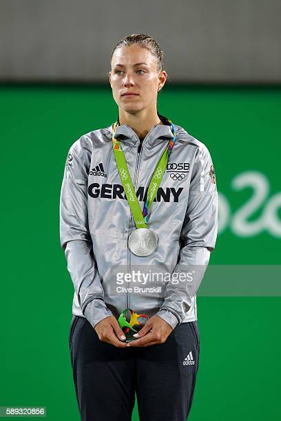 Silver medalist Angelique Kerber of Germany poses during the medal ceremony for the Women's Singles on Day 8 of the Rio 2016 Olympic Games at the...