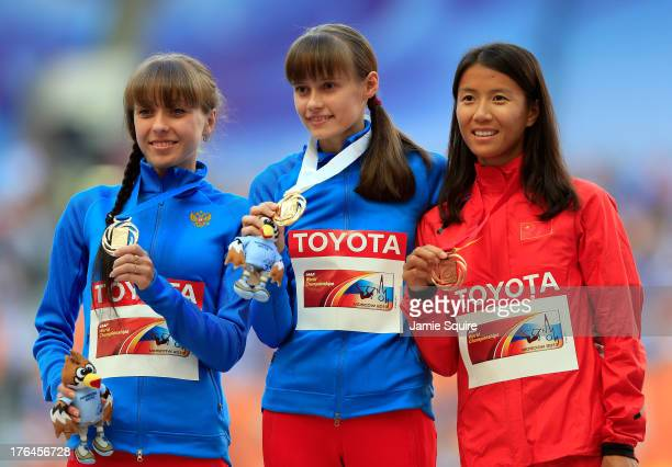 Silver medalist Anisya Kirdyapkina of Russia gold medalist Elena Lashmanova of Russia and bronze medalist Hong Liu of China stand on the podium...