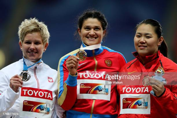silver medalist Anita Wlodarczyk of Poland gold medalist Tatyana Lysenko of Russia and bronze medalist Wenxiu Zhang of China pose on the podium...
