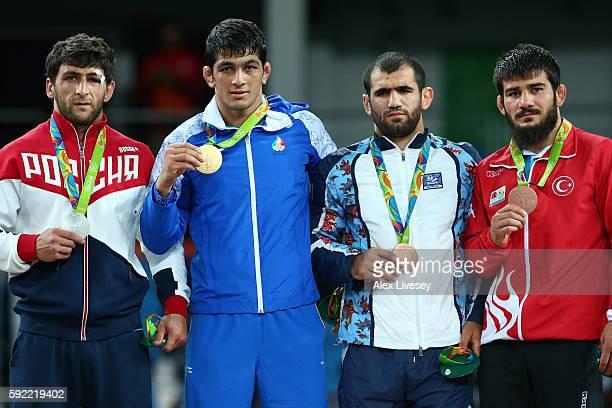 R] Silver medalist Aniuar Geduev of Russia gold medalist Hassan Aliazam Yazdanicharati of the Islamic Republic of Iran bronze medalist Jabrayil...