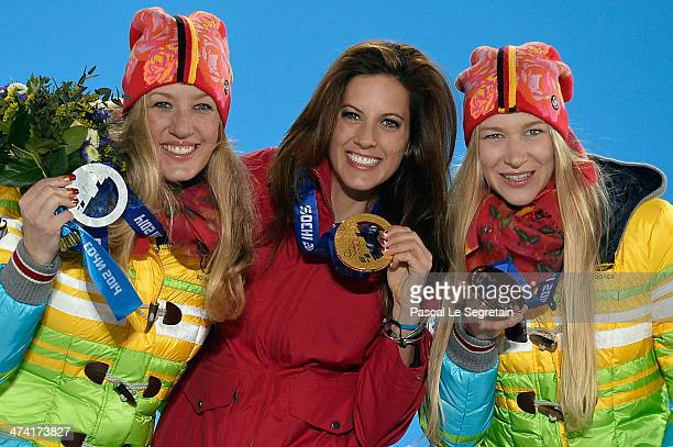 Silver medalist Anke Karstens of Germany gold medalist Julia Dujmovits of Austria and bronze medalist Amelie Kober of Germany celebrate during the...