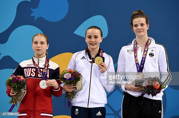 Silver medalist Anna Chuinyshena of Russia gold medalist Lois Toulson of Great Britain and bronze medalist Elena Wassen of Germany pose with the...