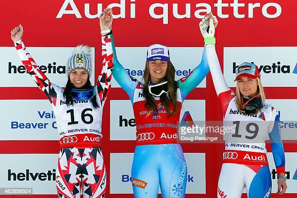 Silver medalist Anna Fenninger of Austria gold medalist Tina Maze of Slovenia and bronze medalist Lara Gut of Switzerland celebrate on the podium...