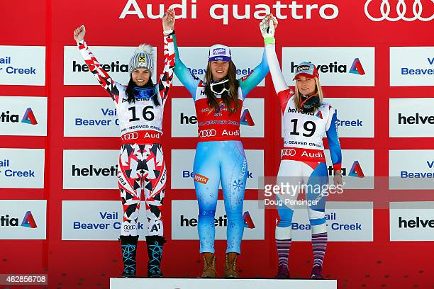 Silver medalist Anna Fenninger of Austria gold medalist Tina Maze of Slovenia and bronze medalist Lara Gut of Switzerland celebrate on the podium...