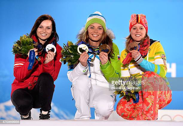 Silver medalist Anna Fenninger of Austria gold medalist Tina Maze of Slovenia and bronze medalist Viktoria Rebensburg of Germany celebrate on the...