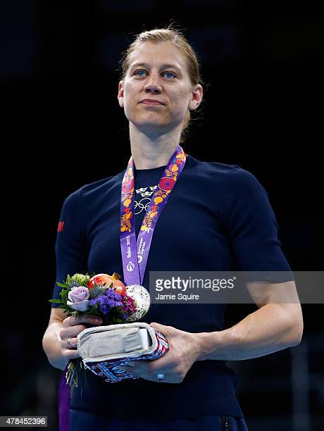 Silver medalist Anna Laurell Nash of Sweden stands on the podium during the medal ceremony for the Women's Middleweight 6975kg final on day thirteen...