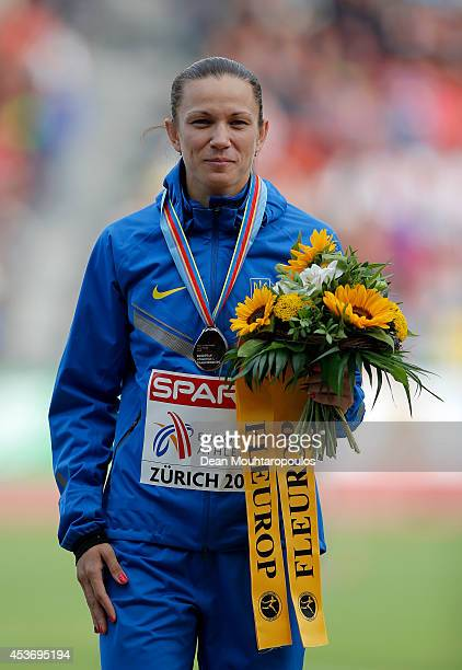 Silver medalist Anna Titimets of Ukraine stands on the podium during the medal ceremony for the Women's 400 metres hurdles final during day five of...