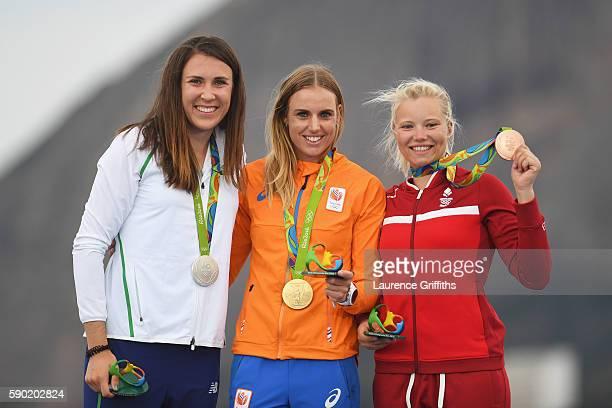 Silver medalist Annalise Murphy of Ireland gold medalist Marit Bouwmeester of the Netherlands and bronze medalist AnneMarie Rindom of Denmark...