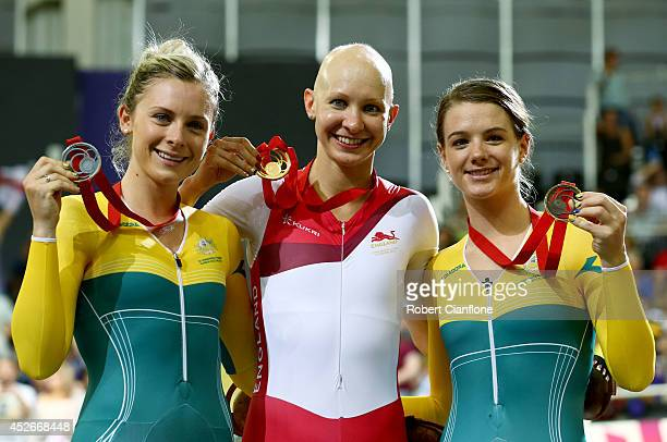 Silver medalist Annette Edmondson of Australia gold medalist Joanna Rowsell of England and bronze medalist Amy Cure of Australia pose on the podium...
