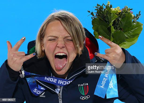 Silver medalist Arianna Fontana of Italy celebrates during the medal ceremony for the Short Track Speed Skating Ladies' 500 m on day six of the Sochi...
