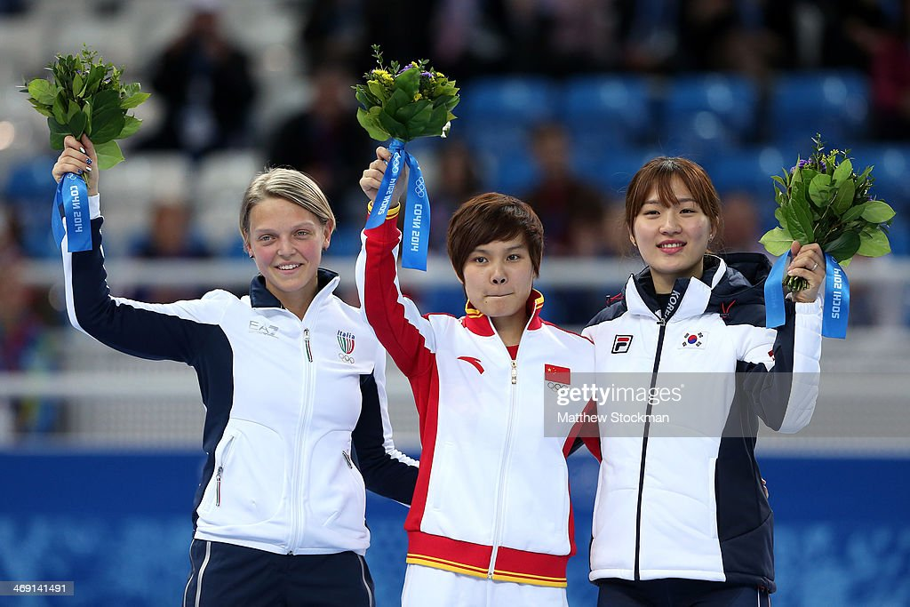 Silver medalist Arianna Fontana of Italy, gold medalist Jianrou Li of China and bronze medalist Seung-Hi Park of Korea during the flower ceremony for the Short Track Speed Skating Ladies' 500 m Final on day 6 of the Sochi 2014 Winter Olympics at at Iceberg Skating Palace on February 13, 2014 in Sochi, Russia.