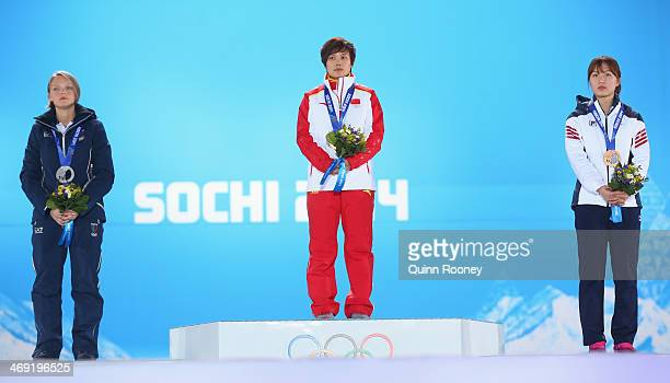 Silver medalist Arianna Fontana of Italy gold medalist Jianrou Li of China and bronze medalist SeungHi Park of Korea celebrate during the medal...