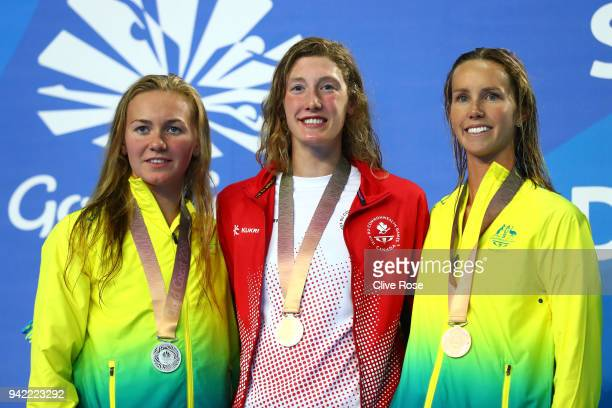 Silver medalist Ariarne Titmus of Australia gold medalist Taylor Ruck of Canada and bronze medalist Emma Mckeon of Australia pose during the medal...