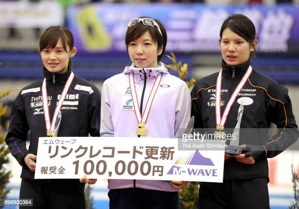silver medalist Arisa Go gold medalist Nao Kodaira and bronze medalist Erin Kamiya pose on the podium at the medal ceremony for the Ladies 500m...