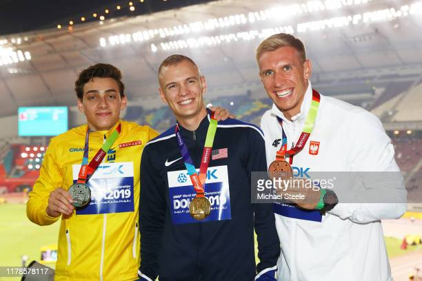 Silver medalist Armand Duplantis of Sweden gold medalist Sam Kendricks of the United States and bronze medalist Piotr Lisek of Poland stand on the...