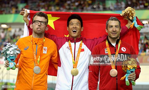 Silver medalist Arnoud Nijhuis of Netherlands gold medalist Zhangyu Li of China and bronze medalist Tristen Chernove of Canada celebrate on the...