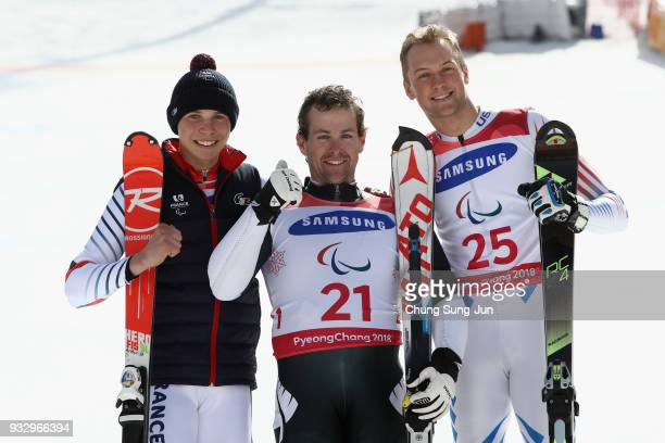 Silver medalist Arthur Bauchet of France gold medalist Adam Hall of New Zealand and bronze medalist Jamie Stanton of the United States celerbate...