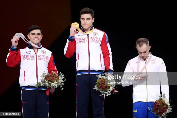Silver medalist Artur Dalaloyan of Russia gold medalist Nikita Nagornyy of Russia and bronze medalist Oleg Verniaiev of Ukraine pose with their...