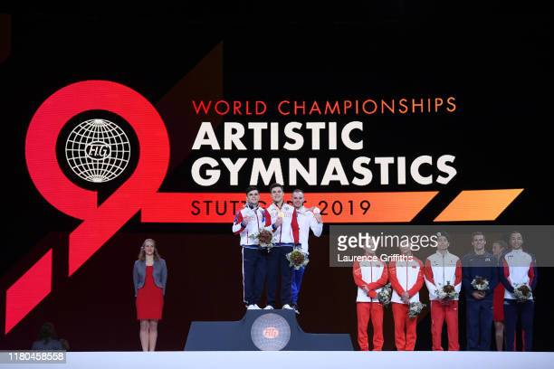 Silver medalist Artur Dalaloyan of Russia gold medalist Nikita Nagornyy of Russia bronze medalist Oleg Verniaiev of Ukraine fourth placed Ruoteng...