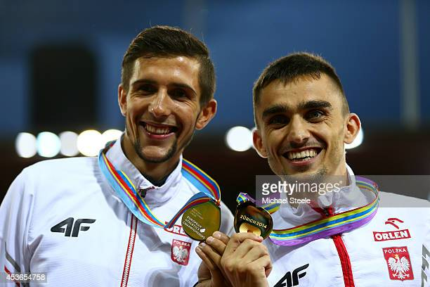 Silver medalist Artur Kuciapski of Poland and gold medalist Adam Kszczot of Poland pose with their medals on the podium during the medal ceremony for...