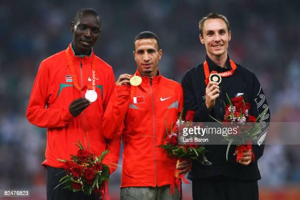 Silver medalist Asbel Kipruto Kiprop of Kenya, gold medalist Rasheed Ramzi of Bahrain and bronze medalist Nick Willis of New Zealand pose after...