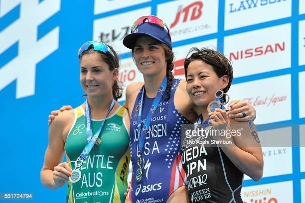 Silver medalist Ashleigh Gentle of Australia gold medalist Gwen Jorgensen and bronze medalist Ai Ueda of Japan pose on the podium at the medal...