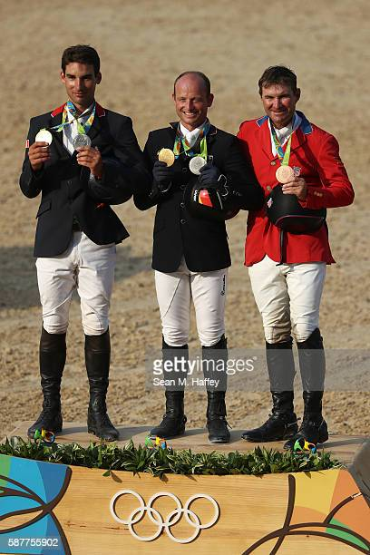 Silver medalist Astier Nicolas of France Gold medal medallist Michael Jung of Germany and bronze medallist Phillip Dutton of the United States pose...