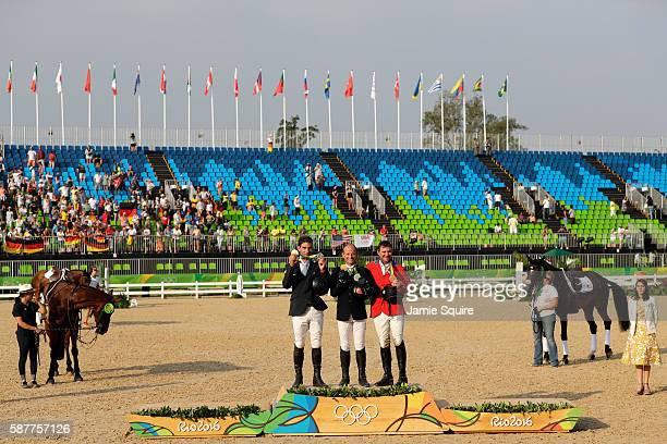 Silver medalist Astier Nicolas of France, Gold medal medallist Michael Jung of Germany and bronze medallist Phillip Dutton of the United States pose...