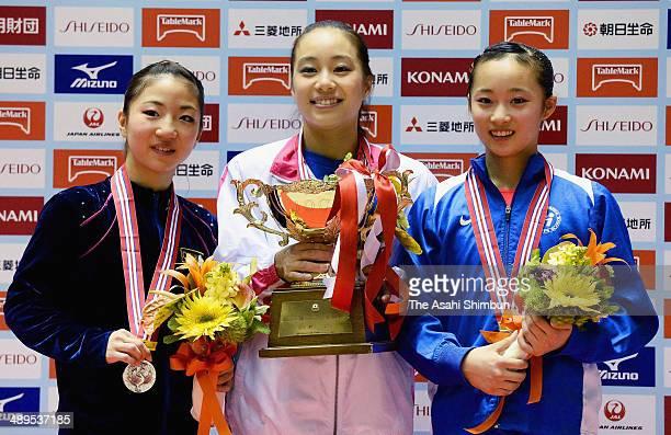 Silver medalist Asuka Teramoto gold medalist Natsumi Sasada and bronze medalist Yuna Hiraiwa pose for photographs on the podium during day three of...