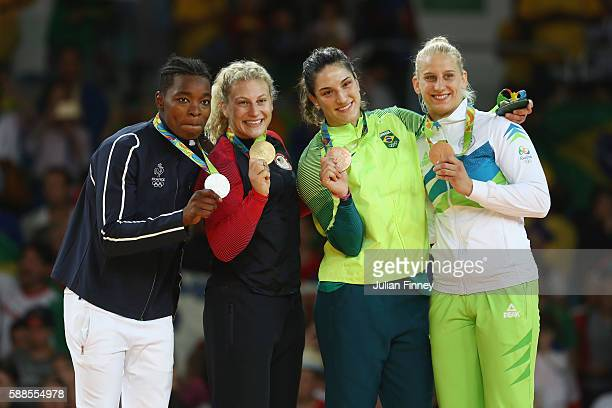 Silver medalist Audrey Tcheumeo of France gold medalist Kayla Harrison of the United States and bronze medalists Mayra Aguiar of Brazil and Anamari...