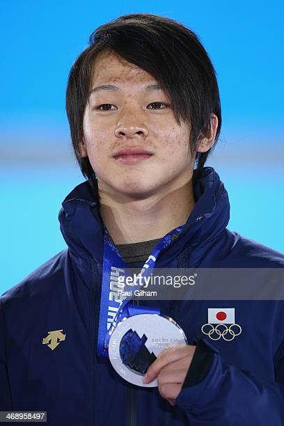 Silver medalist Ayumu Hirano of Japan celebrates during the medal for the Snowboard Men's Halfpipe on day five of the Sochi 2014 Winter Olympics at...