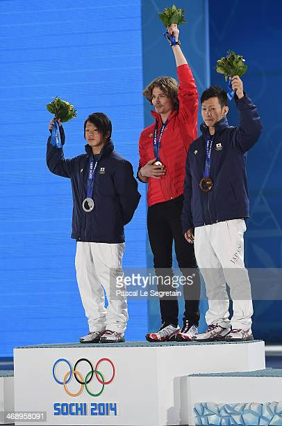Silver medalist Ayumu Hirano of Japan, gold medalist Iouri Podladtchikov of Switzerland and bronze medalist Taku Hiraoka of Japan celebrate on the...