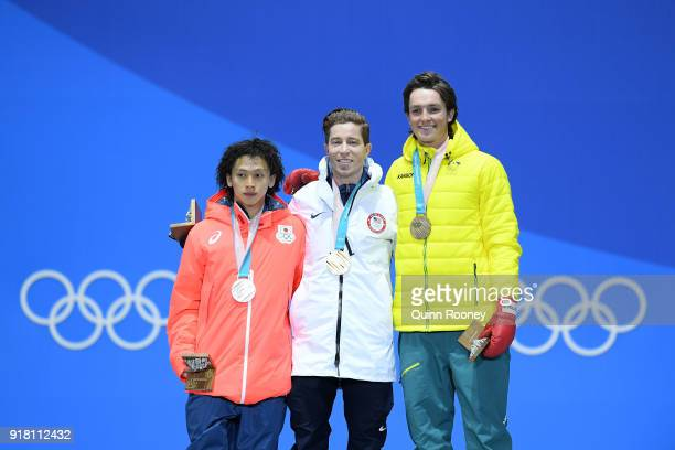 Silver medalist Ayumu Hirano of Japan gold medalist Shaun White of the United States and bronze medalist Scotty James of Australia pose during the...