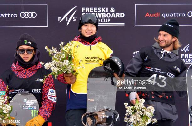 Silver medalist Ayumu Hirano of Japan Gold medalist Yuto Totsuka of Japan and Patrick Burgener of Switzerland pose on the podium after the Winter...