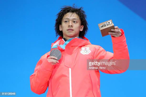 Silver medalist Ayumu Hirano of Japan poses during the medal ceremony for the Snowboard Men's Halfpipe Final on day five of the PyeongChang 2018...