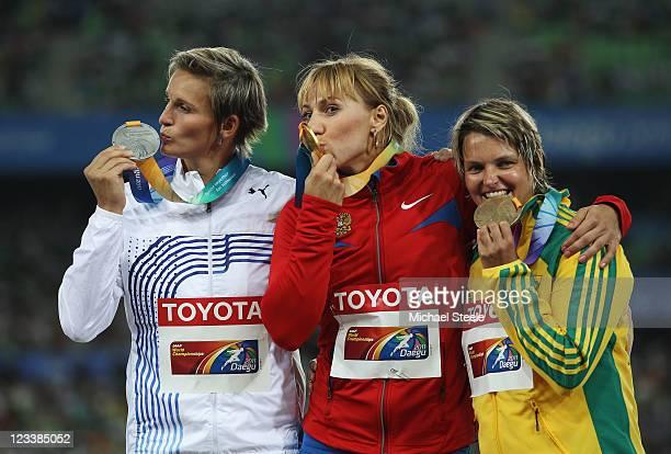 Silver medalist Barbora Spotakova of Czech Republic, gold medalist Maria Abakumova of Russia and bronze medalist Sunette Viljoen of South Africa...