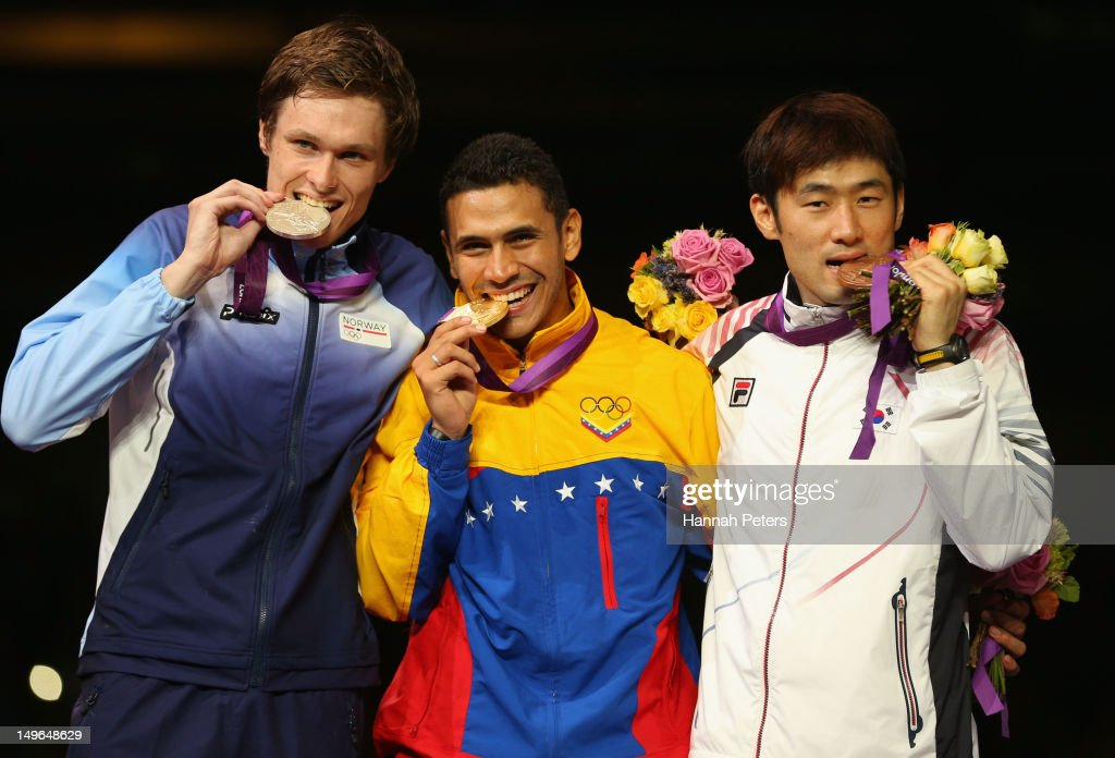 Silver medalist Bartosz Piasecki of Norway, gold medalist Ruben Limardo Gascon of Venezuela and Jinsun Jung of Korea pose on the podium during the medal ceremony for the Men's Epee Individual Fencing on Day 5 of the London 2012 Olympic Games at ExCeL on August 1, 2012 in London, England.