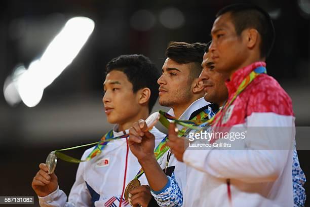 Silver medalist Baul An of Korea gold medalist Fabio Basile of Italy and bronze medalists Rishod Sobirov of Uzbekistan and Masashi Ebinuma of Japan...