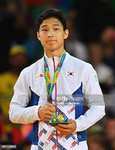 Silver medalist Baul An of Korea stands on the podium during the medal ceremony for the Men's 66kg Judo on Day 2 of the Rio 2016 Olympic Games at...