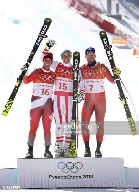 Silver medalist Beat Feuz of Switzerland gold medalist Matthias Mayer of Austria and bronze medalist Kjetil Jansrud of Norway celebrate during the...