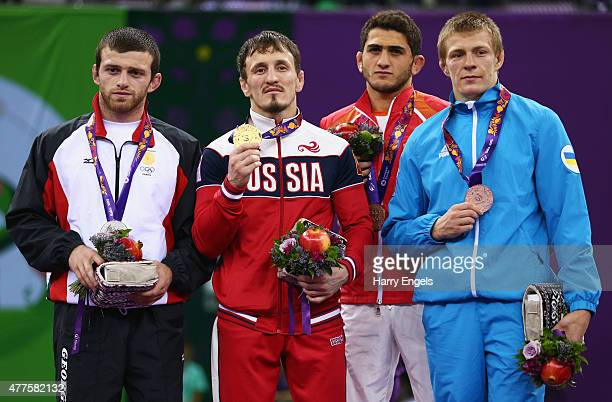 Silver medalist Beka Lomtadze of Georgia gold medalist Aleksandr Bogomoev of Russia and bronze medalists Haji Aliyev of Azerbaijan and Vasyl Shuptar...