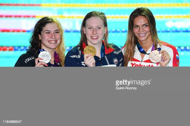 Silver medalist Benedetta Pilato of Italy gold medalist Lilly King of the United States and Yulia Efimova of Russia pose during the medal ceremony...