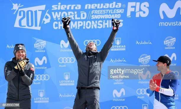 Silver medalist Benjamin Karl of Austria gold medalist Andreas Prommegger of Austria and bronze medalist Nevin Galmarini of Switzerland celebrates...